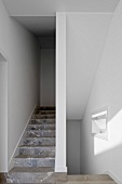 A narrow staircase with marble stairs