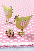 Metal chicken ornaments and a quail's egg