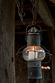 An old lantern with a candle as lighting on a terrace