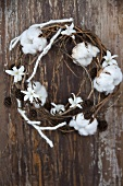 A wreath of alder and cotton with hyacinth flowers