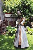 A figure made of scrap metal in a garden