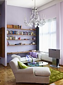 A chaise lounge, a day bed and a shelf in a living room with pink walls
