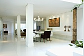 An elegant hallway with a dining area