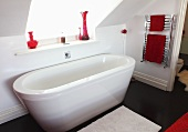A free-standing bathtub below a skylight
