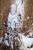 An oriental sculpture in the snow