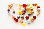 Colourful glass marbles shaped like a heart