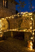 A terrace illuminated with fairy lights in the evening