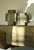 Cross-shaped decorative objects on a wooden beam