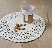 A cup and almonds on a place mat