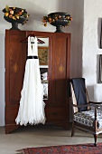 Elegant white dress hanging on a wardrobe