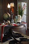 Assorted antiques and other collectibles and on a table with the Union Jack as a tablecloth