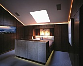 Dramatic lighting in a man's bedroom