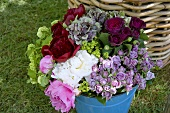 Hydrangea and roses in a pail