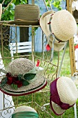 Summer hats on a rack in the garden