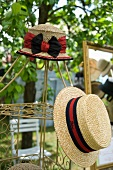 Straw hats on a frame outside