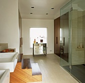 A walk-in shower cubicle with glass doors in a modern bathroom