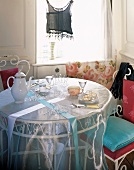 A round coffee table with an elegant tablecloth