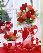 Valentine's Day table decoration of flowers & fairy lights