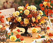 Autumnal arrangement of roses and rose hips