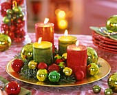 Advent wreath with candles and Christmas baubles