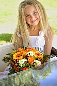 Blond girl with bouquet of flowers