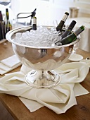 White wine bottles in an ice bucket