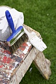 Painting accessories: paint brush, paint and stool