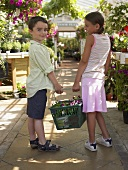 Children shopping at a garden centre