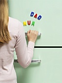 Words written with magnets on refrigerator
