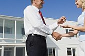 A woman and an estate agent shaking hands