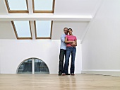 A picture of a couple in a new house