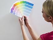 A woman looking at colour charts