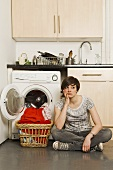 A bored looking young woman with washing