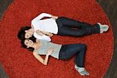 Women lying on rug