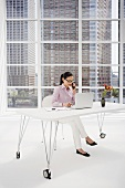 Japanese businesswoman at desk