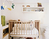 A baby's bedroom with teddy bears in the cot
