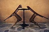 Wooden chairs leaning against a table