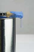 Paint dripping off a paintbrush