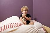 Boy in bed with teddy bear
