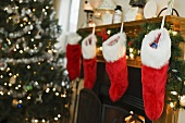 Christmas stockings hanging by a fireplace