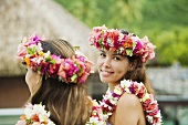 Young women with flowers in hair in moorea