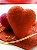Red hearts as table decoration for Valentine's Day