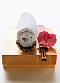 Asian table accessories: washcloth, chopsticks, orchid