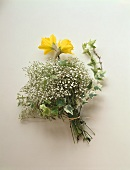 Spring bouquet of daffodils, gypsophila and ivy