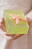 Girl holding green soap with starfish