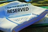 Reserved sign on a tablecloth out of doors