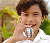 Boy holding an Easter egg in his hand