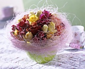 Arrangement of mixed roses with sisal