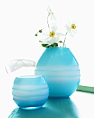 Blue glass vases one with white Japanese anemones