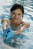 Woman in bath gloves in water